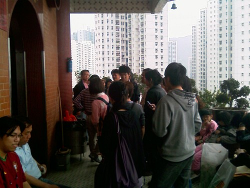 People gathered outside on the balcony